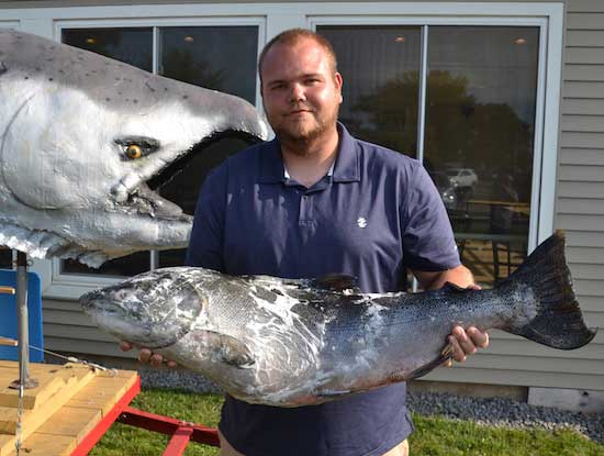 Keith Sheffield of Henrietta holds a 30-pound, 9-ounce Chinook that led the derby for more than a week. He won $500 as the salmon division leader.