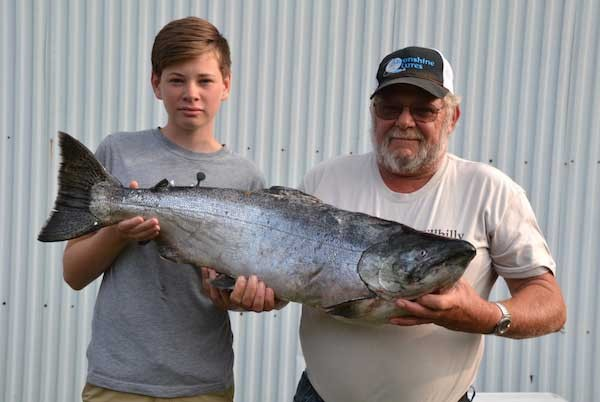 Dane Ballard, 14, of Aberdeen Proving Grounds in Maryland holds a 26-pound, 3-ounce salmon he caught with his grandfather, Denny Jackson of Ogdensburg, Pa. The fish was the second place salmon in the derby.